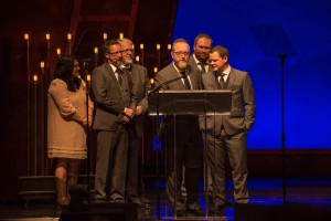 Members of Balsam Range (Buddy Melton, Marc Pruett, Tim Surrett, Darren Nicholson, Caleb Smith) accept one of several awards in Raleigh during the IBMA Awards. Also pictures is artist Amanda Smith, award presenter. Photo credit: Todd Powers.